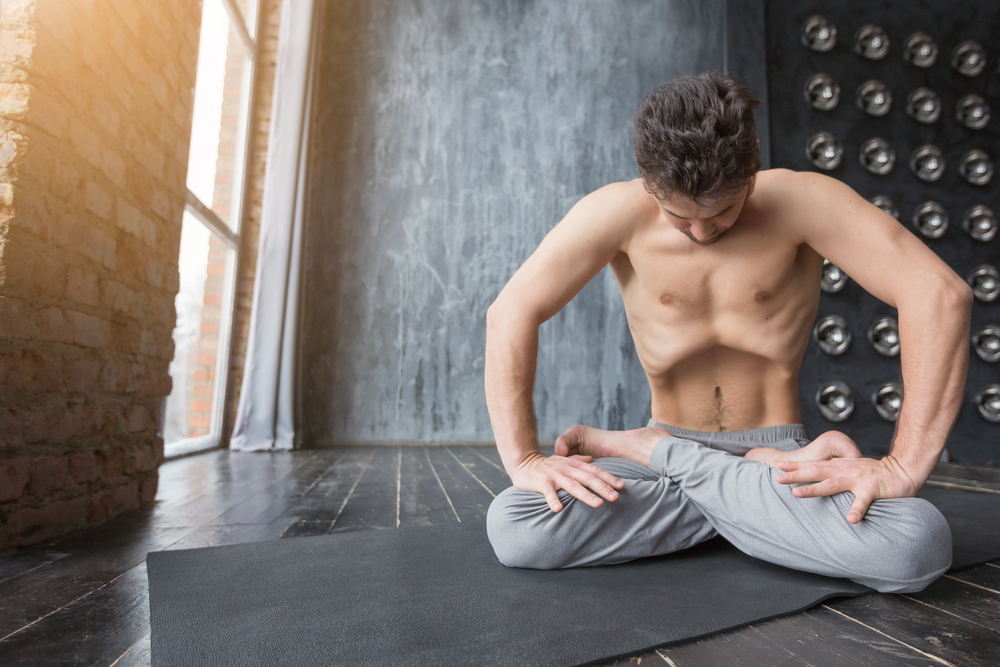 Yoga.,Portrait,Of,Yogi,Men,Doing,Yoga,Exercise,On,Black